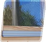 Dubbelglasade dörrar och fönster med fönsterbleck i aluminium